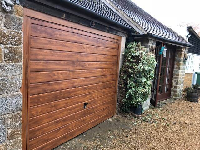 Love the warmth of a stylish wood grained garage door?