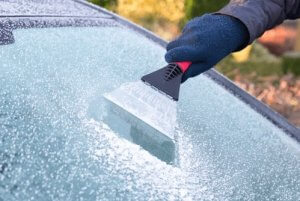 Deicing Car in Winter